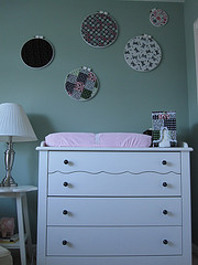 White four-drawer baby dresser