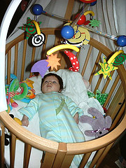 Infant inside a circular crib
