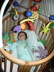 Infant inside a circular crib
